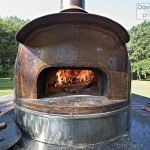 The wood burning oven trailer that Chef Hitz brings to Gracie's for one special dinner each year.