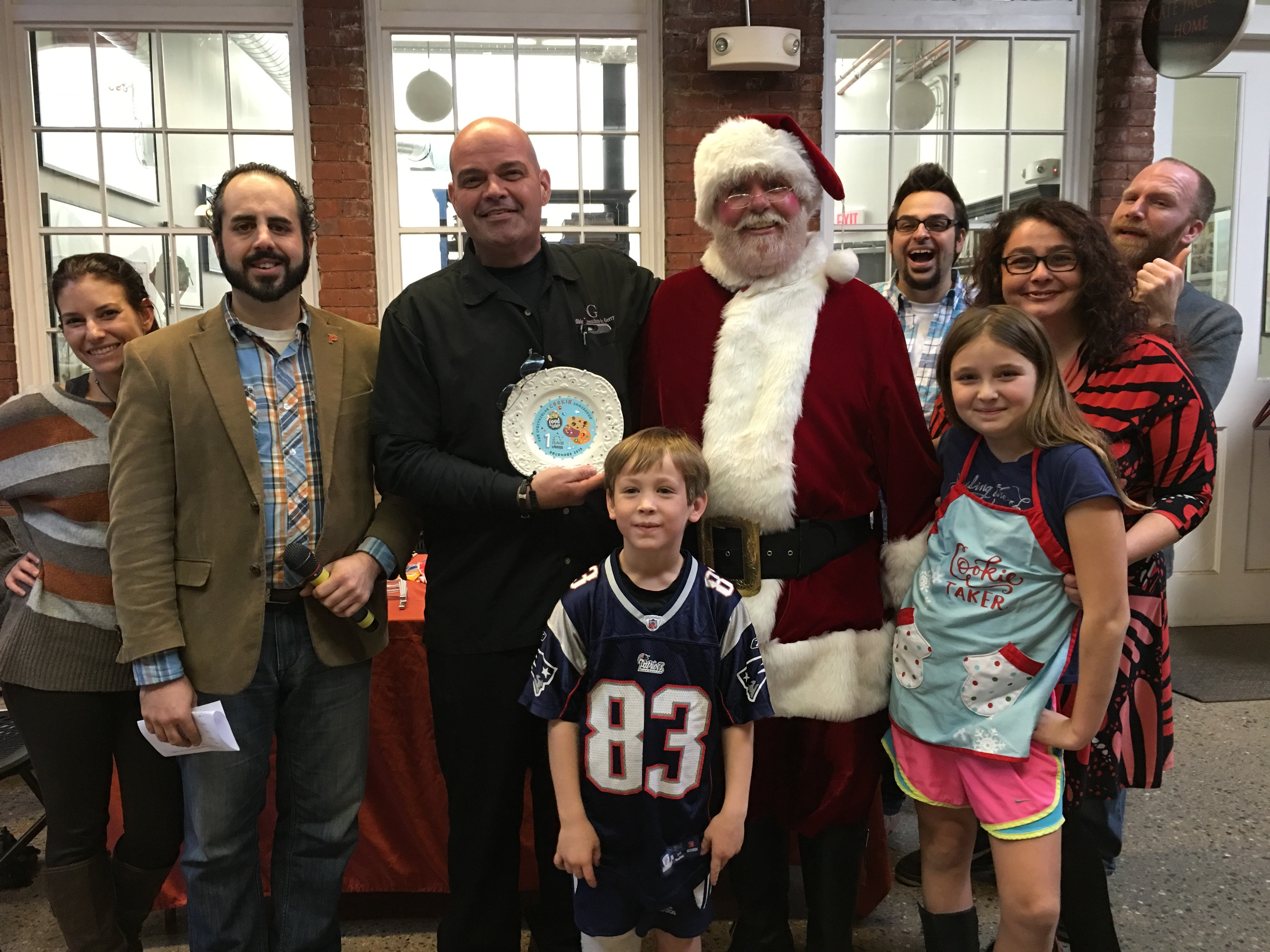 RI Food Fights Spectacular Cookie Smackdown winner Edible Creations by Gerry surrounded by Santa and the judges