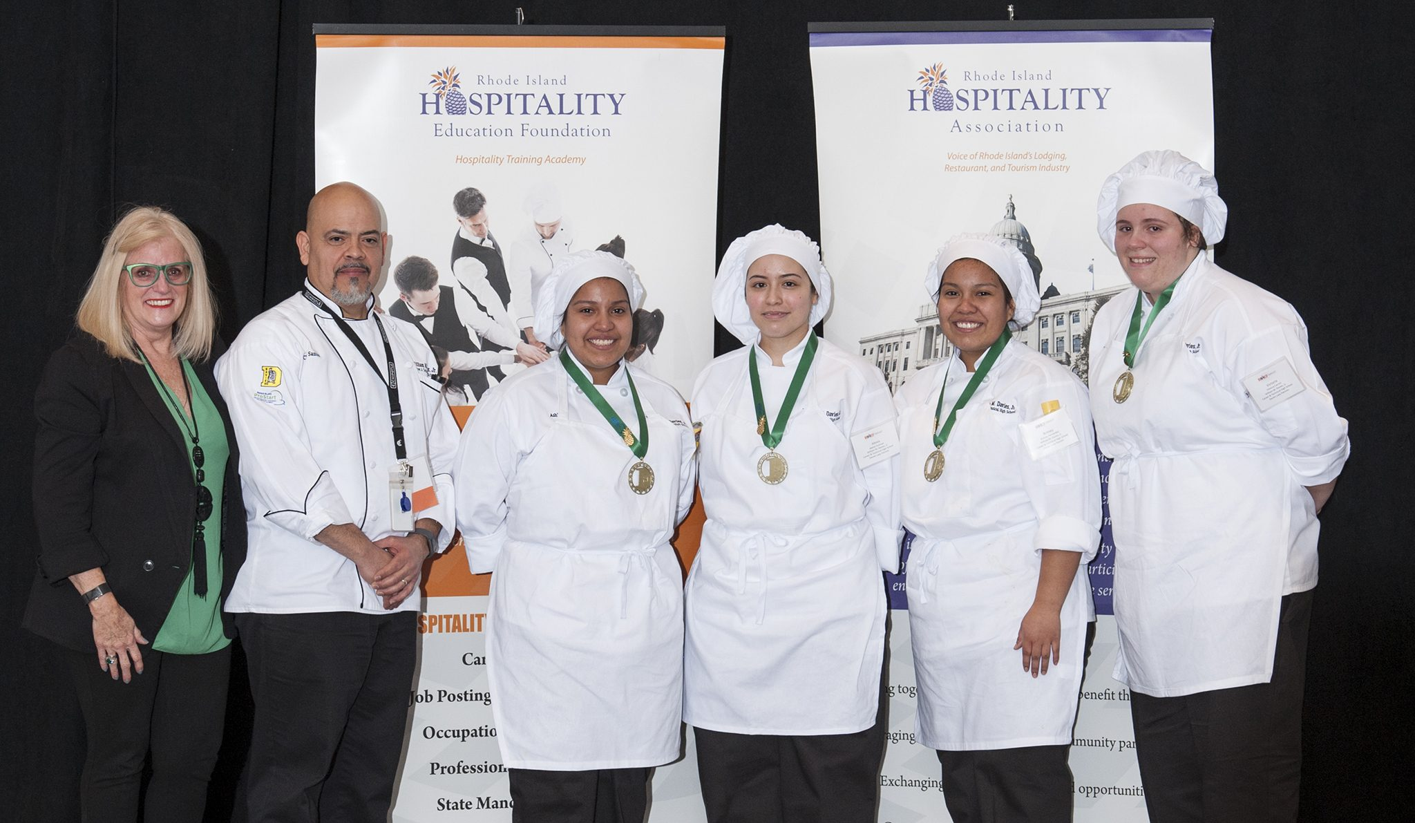 ProStart Culinary Arts Competition Winners from William M. Davies, Jr. Career & Technical High School: (From left to right): Dale J. Venturini, President/CEO of RIHA/RIHEF; Chef Instructor Santos Nieves; William M. Davies, Jr. Career & Technical High School students Ashley Fernandez, Alexia Guzman, Britney Fernandez, and Victoria Carron. Photo credit: Richard Kizirian.